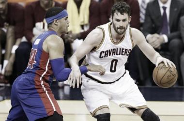 Cleveland Cavaliers' Kevin Love (0) drives past Detroit Pistons' Tobias Harris (34). (AP Photo/Tony Dejak)