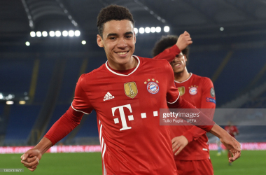 ROME, ITALY - FEBRUARY 23: Jamal Musiala of FC Bayern Muenchen celebrates after scoring their side's second goal during the UEFA Champions League Round of 16 match between Lazio Roma and Bayern München at Olimpico Stadium on February 23, 2021 in Rome, Italy. Sporting stadiums around Italy remain under strict restrictions due to the Coronavirus Pandemic as Government social distancing laws prohibit fans inside venues resulting in games being played behind closed doors. (Photo by Tullio Puglia - UEFA/UEFA via Getty Images)