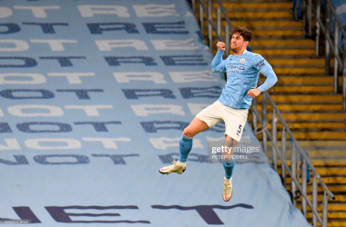 <div>Manchester City's English defender John Stones celebrates after scoring the opening goal during the English Premier League football match between Manchester City and Crystal Palace at the Etihad Stadium in Manchester, north west England, on January 17, 2021. (Photo by PETER POWELL / POOL / AFP) / RESTRICTED TO EDITORIAL USE. No use with unauthorized audio, video, data, fixture lists, club/league logos or 'live' services. Online in-match use limited to 120 images. An additional 40 images may be used in extra time. No video emulation. Social media in-match use limited to 120 images. An additional 40 images may be used in extra time. No use in betting publications, games or single club/league/player publications. / (Photo by PETER POWELL/POOL/AFP via Getty Images)</div>