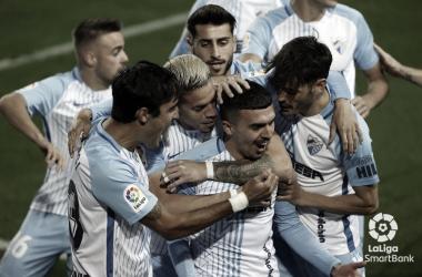 El equipo malacitano celebrando el gol de Joaquín Muñoz. / Foto: LaLiga