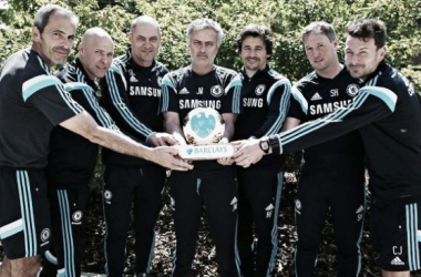 José (pictured, fourth) poses with his accolade with the back-room staff