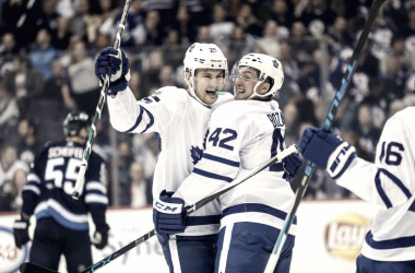James van Riemsdyk (left) and Tyler Bozak (right) celebrate a goal together on the opening night of the 2017-18 season.. The long-time linemates may both be on their way out of Toronto. Photo: Terrence Lee/USA Today
