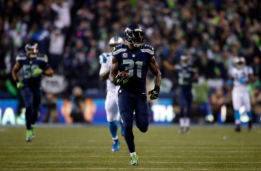 Kam Chancellor (31) returns an interception for a touchdown in the 2014 divisional playoffs against the Carolina Panthers. He ended his holdout and reported to the 0-2 Seattle Seahawks on Wednesday. Seattle faces another 0-2 team, the Chicago Bears, on Su