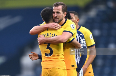 Harry Kane of Tottenham Hotspur celebrates with team mate Sergio Reguilon following the Premier League match between West Bromwich Albion and Tottenham Hotspur at The Hawthorns on November 08, 2020 in West Bromwich, England. Sporting stadiums around the UK remain under strict restrictions due to the Coronavirus Pandemic as Government social distancing laws prohibit fans inside venues resulting in games being played behind closed doors. (Photo by Laurence Griffiths/Getty Images)
