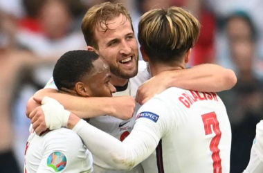 <div>England's forward Harry Kane (C) celebrates with England's forward Raheem Sterling (L) and England's midfielder Jack Grealish after their win in the UEFA EURO 2020 round of 16 football match between England and Germany at Wembley Stadium in London on June 29, 2021. (Photo by Andy Rain / POOL / AFP) (Photo by ANDY RAIN/POOL/AFP via Getty Images)</div>