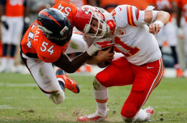 Quarterback Alex Smith #11 of the Kansas City Chiefs is sacked by outside linebacker Brandon Marshall #54 of the Denver Broncos during a game at Sports Authority Field at Mile High on September 14, 2014 in Denver, Colorado.(September 13, 2014-