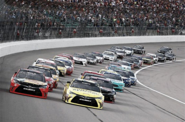 Martin Truex Jr., driver of the #78 Bass Pro Shops/TRACKER Boats Toyota Toyota, and Matt Kenseth, driver of the #20 Dollar General Toyota, lead the field at the start of the NASCAR Sprint Cup Series Go Bowling 400 at Kansas Speedway. (Jamie Squi