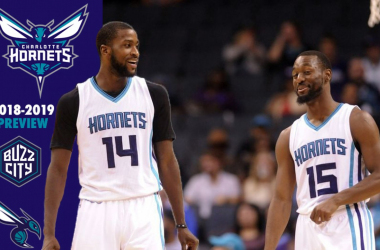 Charlotte Hornets forward Michael Kidd-Gilchrist (14) talks with guard Kemba Walker (15) during the second half of the game against the Miami Heat at the Spectrum Center. Hornets win 96-88. |Sam Sharpe-USA TODAY Sports|