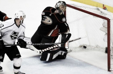 Gaborik (12, white) redirects a shot just past Jonas Hiller to put the Kings up 1-0 in the series.