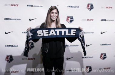 Katie Johnson holding the Reign scarf after being selected by Seattle in the draft | Source: Jenny Chuang-VAVEL USA