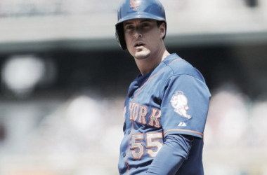 Kelly Johnson looks to manager Terry Collins in the New York Mets dugout. (David Zalubowski/AP)