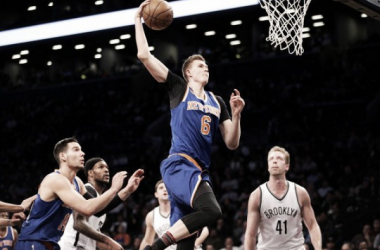 New York Knicks forward Kristaps Porzingis (6) goes for a dunk. Photo: Brad Penner-USA TODAY Sports.