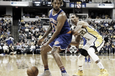 New York Knicks Foward Derrick Williams posts up against Indiana Pacers guard George Hill.Brian Spurlock-USA TODAY Sports