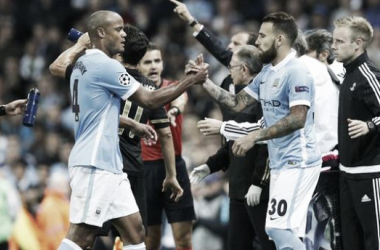 Picture source: BBC Sport - Kompany (pictured, left) being replaced by Otamendi