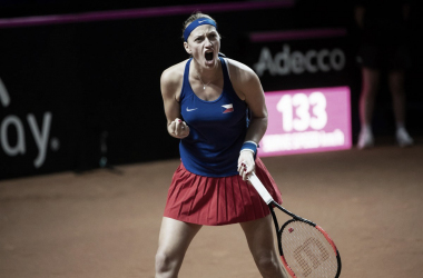 Petra Kvitova roars in delight after winning a hard-fought point | Photo: Paul Zimmer / Fed Cup