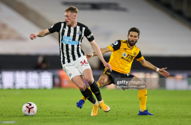 WOLVERHAMPTON, ENGLAND - OCTOBER 25: Sean Longstaff of Newcastle United and Joao Moutinho of Wolverhampton Wanderers during the Premier League match between Wolverhampton Wanderers and Newcastle United at Molineux on October 25, 2020 in Wolverhampton, United Kingdom. Sporting stadiums around the UK remain under strict restrictions due to the Coronavirus Pandemic as Government social distancing laws prohibit fans inside venues resulting in games being played behind closed doors. (Photo by Matthew Ashton - AMA/Getty Images)