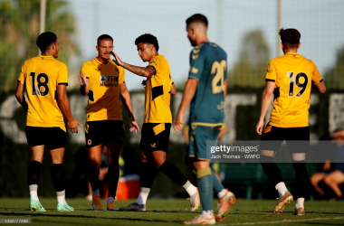Morgan Gibbs-White and Leander Dendoncker congratulate Ki-Jana Hoever after his volley.(Photo by Jack Thomas - WWFC/Wolves via Getty Images)