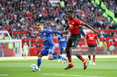 Paul Pogba battles with James Maddison at Old Trafford | Photo: Getty/ Plumb Images