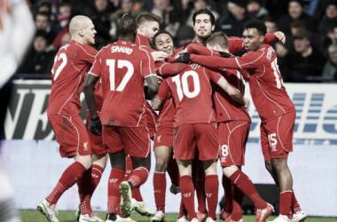 Liverpool celebrate Coutinho's late strike - the winning goal.