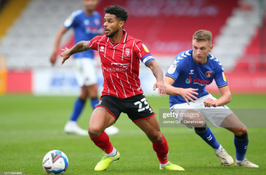 Lincoln captain Liam Bridcutt on the ball when these sides last met at Sincil Bank<div>James Gill - Getty Images</div>