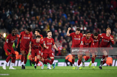 Liverpool celebrate after Curtis Jones's penalty put them through to the quarter finals of the League Cup (Photo by Laurence Griffiths/Getty Images)
