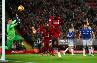 Origi capitalises on a miscued Van Dijk volley and flailing goalkeeping from Pickford | Photo: Getty