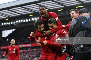 Mohamed Salah of Liverpool celebrates after Toby Alderweireld of Tottenham Hotspur scores an own goal during the Premier League match between Liverpool FC and Tottenham Hotspur at Anfield on March 31, 2019 in Liverpool, United Kingdom. (Photo by Andrew Powell/Liverpool FC via Getty Images)