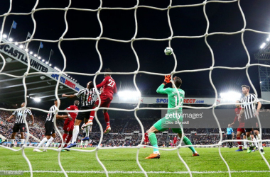 Divock Origi of Liverpool scores his team's third goal past Martin Dubravka of Newcastle United during the Premier League match between Newcastle United and Liverpool FC at St. James Park on May 04, 2019 in Newcastle upon Tyne, United Kingdom. (Photo by Clive Brunskill/Getty Images)