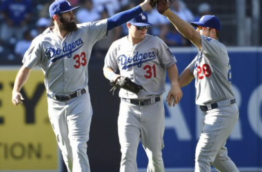 Scott Van Slyke #33 of the Los Angeles Dodgers, left, Joc Pederson #31, center, and /d28/ after the Dodgers beat the San Diego Padres 5-1 in a baseball game at Petco Park September 6, 2015 in San Diego, California.(Sept. 5, 2015 - Source: Denis