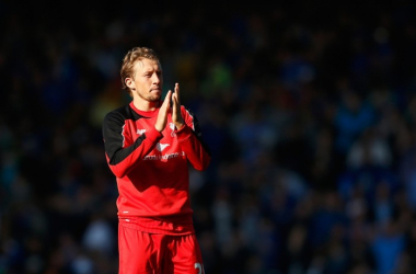 Lucas Leiva has won the respect of Liverpool fans for his hard work, persistence and quality on and off the pitch (Picture: International Business Times)