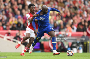 LONDON, ENGLAND - AUGUST 22: Romelu Lukaku of Chelsea is fouled by Nuno Tavares of Arsenal during the Premier League match between Arsenal and Chelsea at Emirates Stadium on August 22, 2021 in London, England. (Photo by Michael Regan/Getty Images)