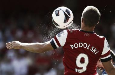 Why was Lukas Podolski a failure at Arsenal?