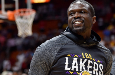 Los Angeles Lakers forward Luol Deng (9) smiles before a game against the Miami Heat at American Airlines Arena. |Steve Mitchell-USA TODAY Sports|
