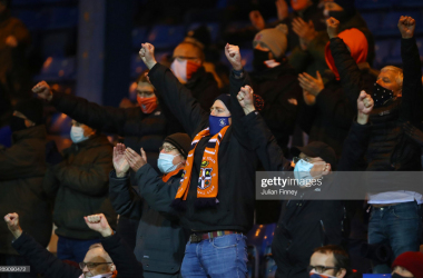 Luton Town fans celebrate the 3-1 win against Norwich in December, as fans were briefly allowed back into stadiums following the temporary easing of restrictions | (Photo by Julian Finney/Getty Images)