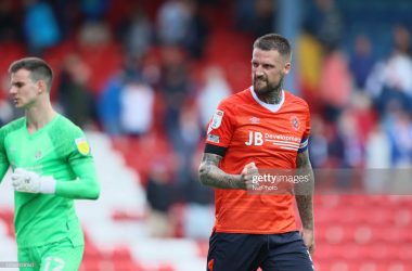 Above: Luton captain Sonny Bradley proudly celebrates his side's remarkable comeback away at Blackburn on Saturday. (Photo by MI News/ NurPhoto via Getty Images).