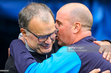 Leeds United manager Marcelo Bielsa is greeted by Wigan Athletic manager Paul Cook before the match during the Sky Bet Championship match between Wigan Athletic and Leeds United at DW Stadium on November 4, 2018 in Wigan, England. (Photo by Alex Dodd - CameraSport via Getty Images)