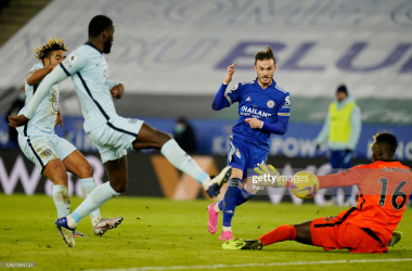 LEICESTER, ENGLAND - JANUARY 19: James Maddison of Leicester City scores their sides second goal past Edouard Mendy of Chelsea during the Premier League match between Leicester City and Chelsea at The King Power Stadium on January 19, 2021 in Leicester, England. Sporting stadiums around the UK remain under strict restrictions due to the Coronavirus Pandemic as Government social distancing laws prohibit fans inside venues resulting in games being played behind closed doors. (Photo by Tim Keeton - Pool/Getty Images)