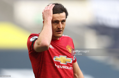 <div>Tottenham Hotspur v Manchester United - Premier League</div><div>LONDON, ENGLAND - APRIL 11: Harry Maguire of Manchester United reacts during the Premier League match between Tottenham Hotspur and Manchester United at Tottenham Hotspur Stadium on April 11, 2021 in London, England. Sporting stadiums around the UK remain under strict restrictions due to the Coronavirus Pandemic as Government social distancing laws prohibit fans inside venues resulting in games being played behind closed doors. (Photo by Marc Atkins/Getty Images)</div>