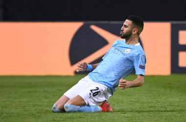 <div>Manchester City's Algerian midfielder Riyad Mahrez celebrates after scoring a goal during the UEFA Champions League first-leg semi-final football match between Paris Saint-Germain (PSG) and Manchester City at the Parc des Princes stadium in Paris on April 28, 2021. (Photo by Anne-Christine POUJOULAT / AFP) (Photo by ANNE-CHRISTINE POUJOULAT/AFP via Getty Images)</div>