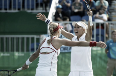 Ekaterina Makarova and Elena Vesnina celebrate after the victory that granted them an Olympic medal [Photo credit: ITF Olympics website]