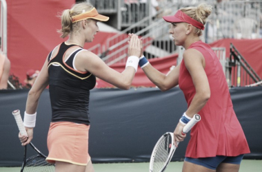 Ekaterina Makarova (L) and Elena Vesnina high-five after winning a point during their second-round match against Bianca Andreescu and Carson Branstine at the 2017 Rogers Cup presented by National Bank. | Photo: Max Gao