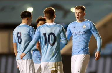 <div>MANCHESTER, ENGLAND - MARCH 12: Liam Delap of Manchester City celebrates with teammates after scoring his team's second goal during the FA Youth Cup match between Manchester City and Birmingham City at Manchester City Football Academy on March 12, 2021, in Manchester, England. (Photo by James Gill - Danehouse/Getty Images)</div>