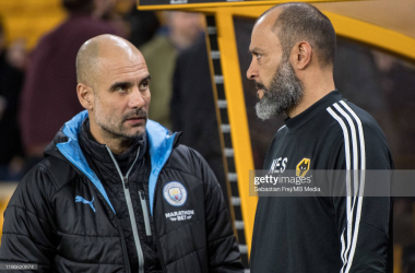 Pep Guardiola and Nuno enjoy a conversation before Wolves' 3-2 win against Manchester City in 2019.(Photo by Sebastian Frej/MB Media/Getty Images)