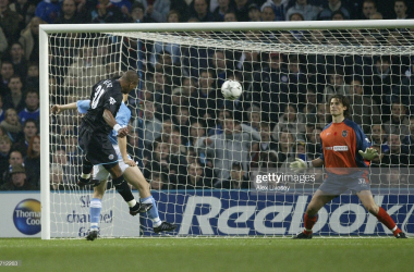 MANCHESTER, ENGLAND - NOVEMBER 9: Marcus Bent of Leicester City heads past Kevin Ellegaard to score the third goal during the Barclaycard Premiership match between Manchester City and Leicester City at the City of Manchester Stadium on November 9, 2003 in Manchester, England. (Photo Alex Livesey/Getty Images)