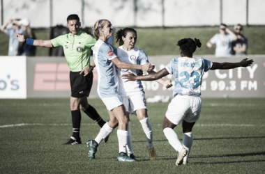 Marta (middle) celebrates her first NWSL goal with her teammates. | Source: @ORLPride