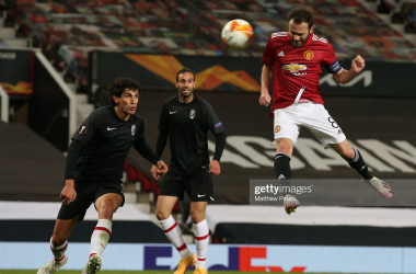 <div>Manchester United v Granada CF - UEFA Europa League Quarter Final: Leg Two</div><div>MANCHESTER, ENGLAND - APRIL 15: Juan Mata of Manchester United heads down for Jesus Vallejo of Granada CF to score an own goal during the UEFA Europa League Quarter Final Second Leg match between Manchester United and Granada CF at Old Trafford on April 15, 2021 in Manchester, England. Sporting stadiums around Europe remain under strict restrictions due to the Coronavirus Pandemic as Government social distancing laws prohibit fans inside venues resulting in games being played behind closed doors. (Photo by Matthew Peters/Manchester United via Getty Images)</div>