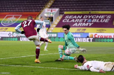 BURNLEY, ENGLAND - JANUARY 09: Lee Nicholls of Milton Keynes Dons makes a save from Matej Vydra of Burnley during the FA Cup Third Round match between Burnley and Milton Keynes Dons at Turf Moor on January 09, 2021 in Burnley, England. The match will be played without fans, behind closed doors as a Covid-19 precaution. (Photo by Alex Pantling/Getty Images)