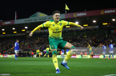 Aarons celebrates after combining with Lewis for the Norwich opener (Photo: Getty Images)