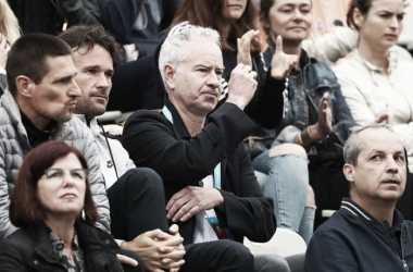 John McEnroe watches the action during the Men's Singles fourth round match between Milos Raonic of Canada and Alberto Ramos Vinolas of Spain on day eight of the 2016 French Open at Roland Garros on May 29, 2016 in Paris, France. Source: Julian Finne