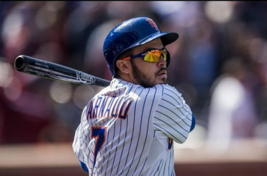 NEW YORK - APRIL 19: Travis d'Arnaud #7of the New York Mets swings in the on-deck circle during the game against the Miami Marlins at Citi Field on Sunday, April 19, 2015 in the Queens borough of New York City. (Photo by Rob Tringali/MLB Photos
